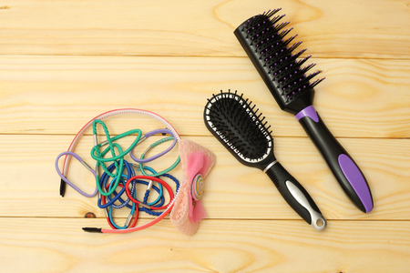 combs for hair on wood background