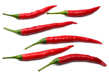 red hot chili peppers isolated on white background top view