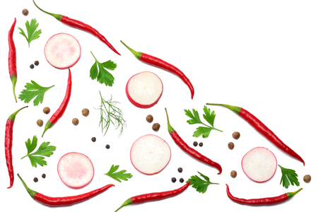 mix red hot chili peppers with parsley and sliced radish and garlic isolated on white background top view Stock Photo