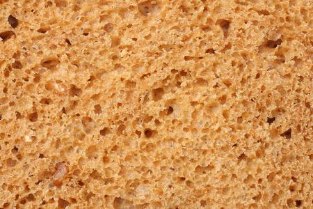 Whole grain bread texture background. macro. top view