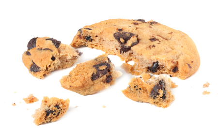 broken chocolate chip cookies isolated on white background. Sweet biscuits. Homemade pastry