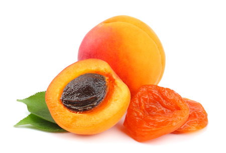 apricot fruits with green leaf and dried apricot isolated on white background Фото со стока