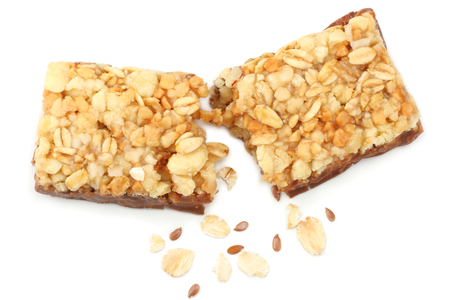 Healthy granola bar ( muesli bar or cereal bar ) isolated on white background. top view