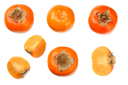 fresh ripe persimmons with slices isolated on white background. top view Stock Photo