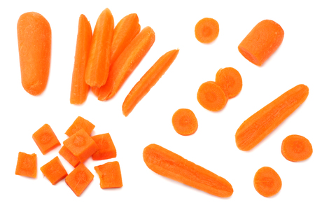 group of organic small baby carrots isolated on a white background. Top view