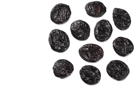 Dried plums - prunes isolated on white background. top view Banque d'images