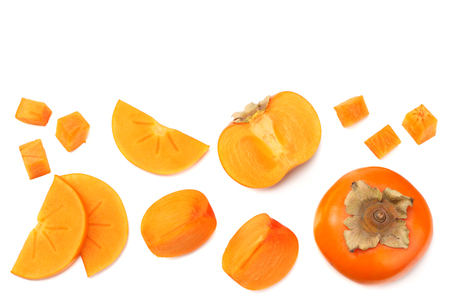 fresh ripe persimmons with slices isolated on white background. top view Stockfoto