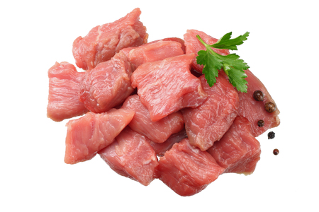 pieces of raw beef meat isolated on white background. top view