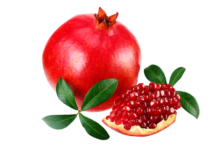 piece of pomegranate with seeds and green leaves isolated on a white background.