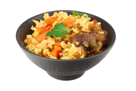 pilaf with meat in black bowl isolated on white background