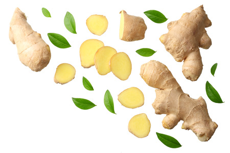 sliced ginger with leaves isolated on white background top view