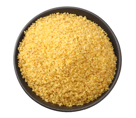 dry bulgur wheat in bowl isolated on white background. top view