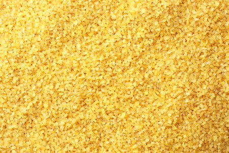 bulgur wheat background. bulgur wheat texture. top view Фото со стока - 124562840