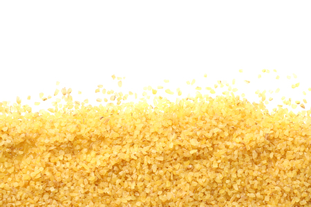 bulgur wheat isolated on white background. top view Фото со стока