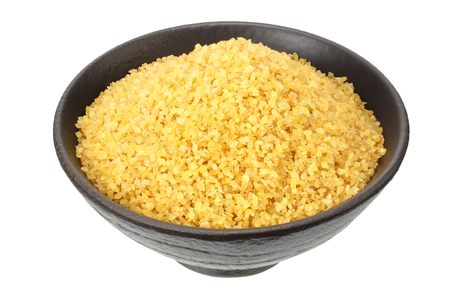 dry bulgur wheat in bowl isolated on white background Фото со стока - 124562906
