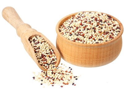 quinoa in a wooden bowl isolated on white background. quinoa seed Фото со стока - 124563138