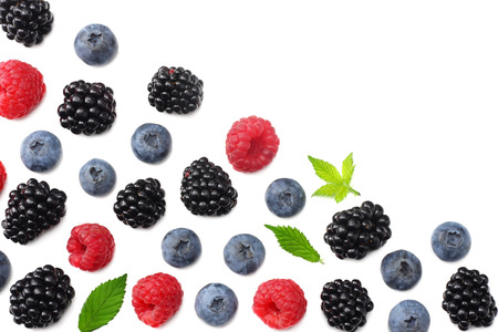 mix of blueberries, blackberries, raspberries isolated on white background. top view with copy space Фото со стока - 124563279