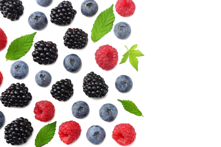mix of blueberries, blackberries, raspberries isolated on white background. top view with copy space Фото со стока - 124563286