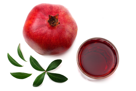 Pomegranate juice with pomegranate isolated on a white background top view. juice in glass Фото со стока