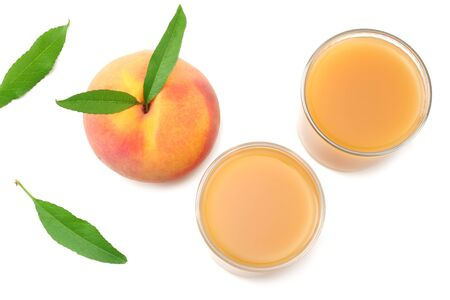 glass of peach juice with peach fruit and green leaf isolated on white background. top view Stock Photo