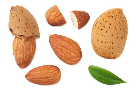almonds with green leaves isolated on white background. top view.