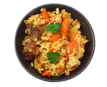 pilaf with meat on black plate isolated on white background. top view Фото со стока