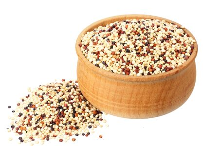 quinoa in a wooden bowl isolated on white background. quinoa seed