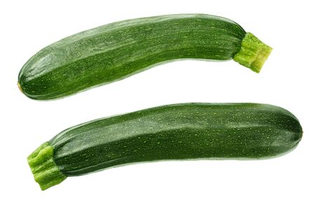 fresh green zucchini with slice isolated on white background. top view Фото со стока
