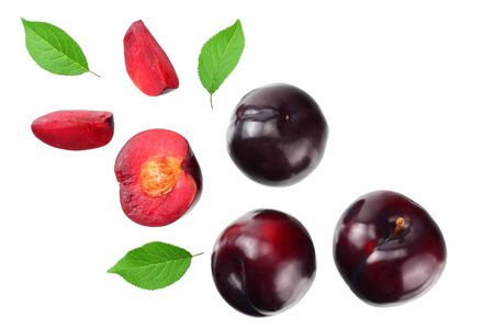 fresh plum fruit with green leaf and cut plum slices isolated on white background. top view