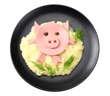 Mashed potatoes with slised boiled ham sausage on plate isolated on white background. pig. top view.