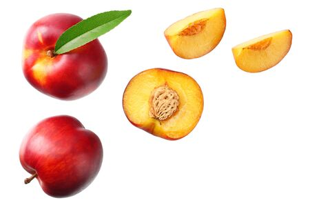 Nectarine with green leaf and slices isolated on white background. top view Stock Photo