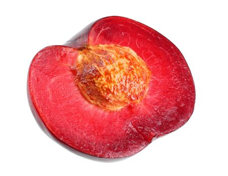 half plum fruit isolated on white background. cut plum slices