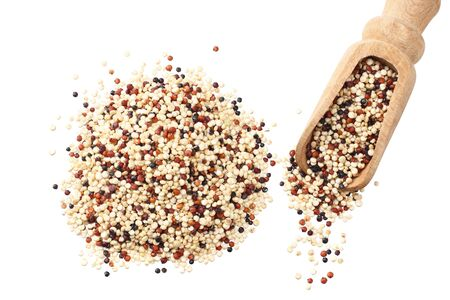 quinoa in a wooden spoon isolated on white background. quinoa seed
