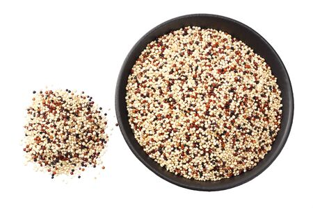 quinoa in a black bowl isolated on white background. quinoa seed. top view Stock Photo
