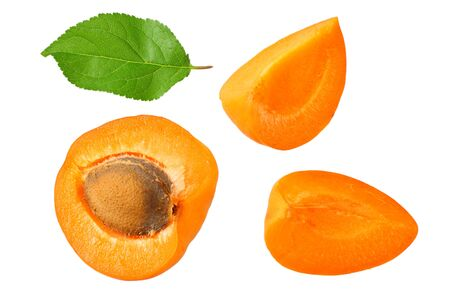 apricot fruits with slices and green leaf isolated on white background. top view Stockfoto