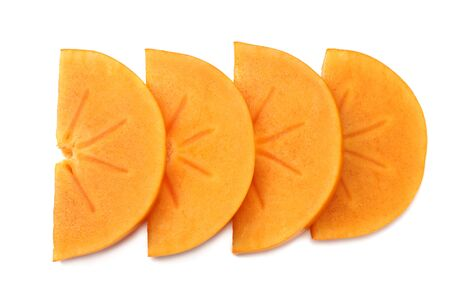 fresh ripe persimmon slices isolated on white background. top view