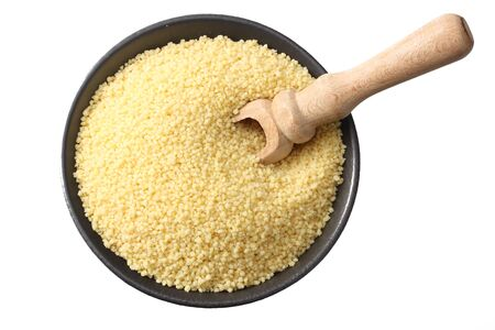 Couscous in black bowl isolated on white background. top view Stok Fotoğraf