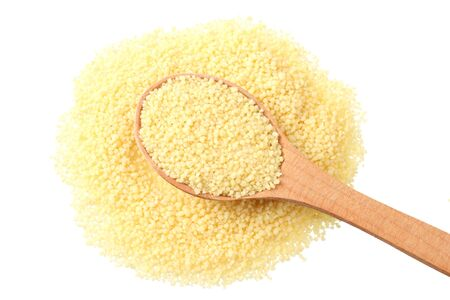 Couscous in wooden spoon isolated on white background. top view