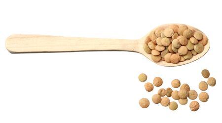 Pile lentil in wooden spoon isolated on white background. Top view.