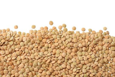 Pile lentil isolated on white background. Top view.