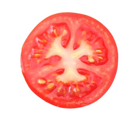 slices of tomato isolated on a white background top view