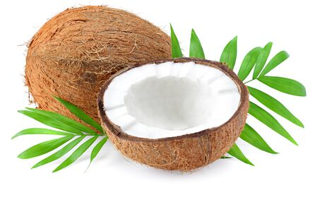 half coconut with green leaves isolated on white background Stockfoto