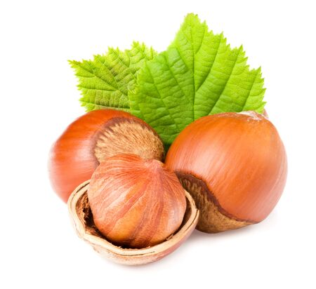 hazelnuts with green leaf isolated on white background Archivio Fotografico