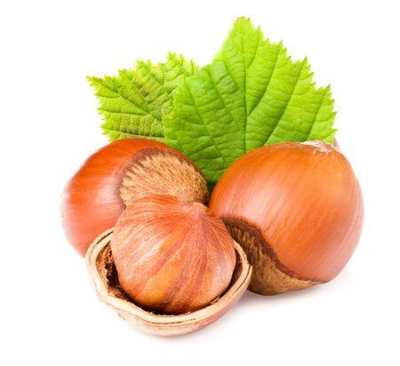 hazelnuts with green leaf isolated on white background Standard-Bild