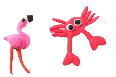plasticine flamingo with crab isolated on white background. modelling clay Foto de archivo
