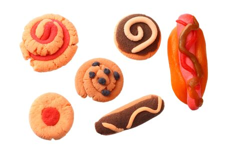 plasticine hot dog with sweets isolated on white background. modelling clay