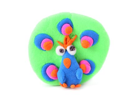 plasticine peacock bird isolated on white background. modelling clay