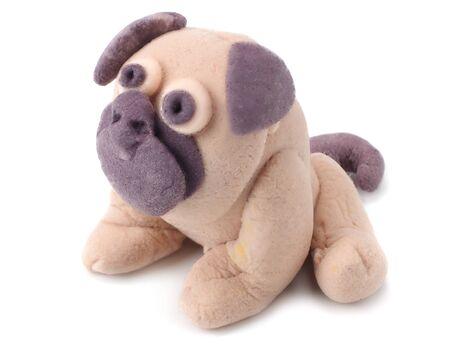 plasticine pug dog isolated on white background. modelling clay