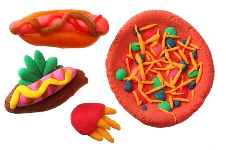 plasticine hot dog, pizza, French fries isolated on white background. modelling clay