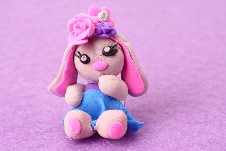 plasticine rabbit on pink background. modelling clay Foto de archivo
